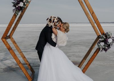 winter frozen lake wedding wood arch